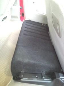 "JL Audio Stealthbox housing a 10"" shallow mount driver."