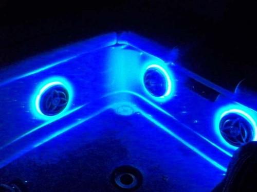 Cockpit speakers and custom LED rings provide plenty of light for rear seating area.